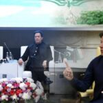 PM Khan shuts a man reciting critical poetry at business forum